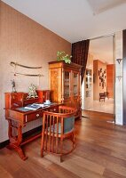 Biedermeier bureau and chair against wall, walnut floor and open glass door in background with view into hall