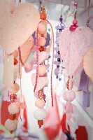 Collection of threaded, suspended decorative hearts and beads