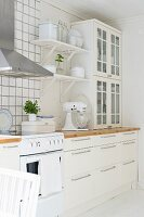 White, shabby-chic, Scandinavian kitchen with modern, stainless steel extractor hood