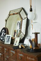 Vintage mirror and flea market finds on old apothecary cabinet