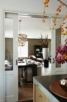 View past partially visible bouquet on counter to sliding doors opening into modern interior