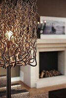 Standard lamp with lampshade made from tangle of curved wire