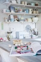 Bulbs of garlic and open cookery book in romantic, vintage kitchen