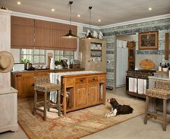 Rustic, country-house kitchen - dog on rug in front of free-standing kitchen counter