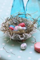 Painted ornamental eggs in Easter nest with crocheted doily