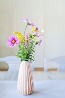 Garden flowers in vase with pleated structure
