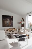 Modern lounge area with white seating on pale tiled floor