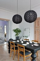Eclectic, elegant dining room in black and white colour scheme with period ambiance