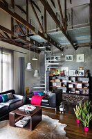 Brown coffee table on animal-skin rug and black leather sofa set in open-plan interior with exposed roof structure, integrated gallery and spiral staircase