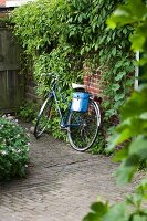 Bicycle leaning against brick house wall