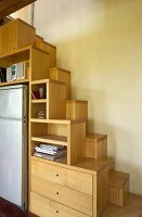 Custom-made wooden cabinets with integrated samba staircase