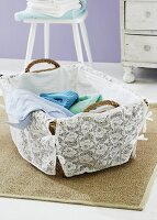 A washing basket decorated with lace