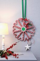 Candy-cane love-hearts arranged in festive wreath tied with ribbon