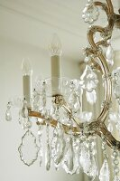Detail of traditional chandelier with crystal pendants