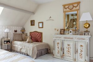 Elegant, antique furnishings and accessories in attic bedroom