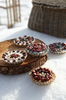 Bird cakes: cakes made from bird food, berries and almonds