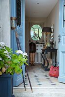 View through open front door into country-house hallway with black console table