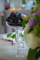 Blueberries and blackberries in stemmed glass