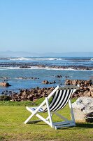 Deckchair on coast with sea view