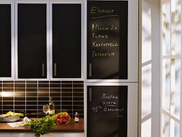 Kitchen cabinet doors revamped with adhesive chalkboard film