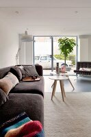 Pale living room with comfortable sofa and view of street