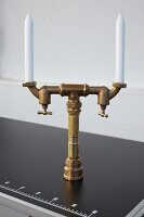 DIY candelabra made from brass pipes and shut-off valves