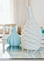 White and pale blue vases with structured surfaces