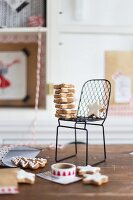 Christmas biscuits on miniature chair & in small gift bag