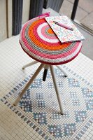 Stool with hand-crafted decorative cover