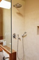 Shower cabinet with rainfall shower and hand spay