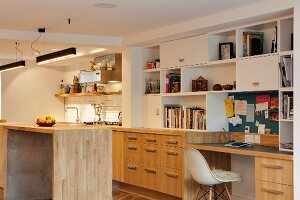 Home office next to kitchen in open-plan interior