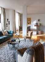 Retro seating and side tables in open-plan interior