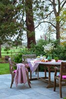Dining area on terrace with horse paddock in background