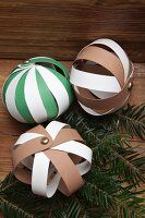 Hand-crafted baubles made from strips of paper