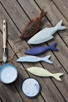 Hand-painted, carved wooden fish as maritime decorations