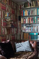 Brown leather couch with scatter cushions in front of bookcases