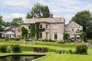 English, stone-built manor house with park-style gardens