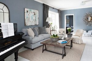 Black piano and lounge area in living room