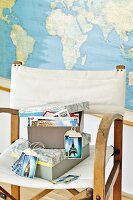 Shoe boxes with lids covered in old maps and hand-crafted gift tags made from holiday photos