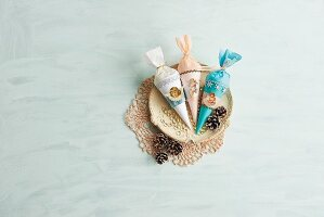 Vintage-style paper cones of sweets with cherub motifs