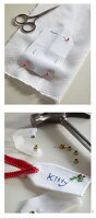 Hand-crafting festive gift tag from white fabric