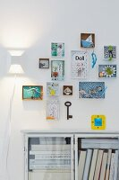 3D pictures hanging on the wall made from small boxes