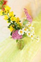 Posy of wild flowers in vase