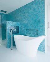 Unusual designer bathtub and floor-mounted taps in elegant bathroom