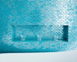 Drinking glasses in niche tiled in blue mosaic tiles