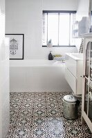 White bathroom with Moroccan-style ornamental tiles on floor