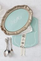 DIY menu board made from pewter platter and decorated place mat