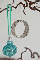 Circular Christmas-tree decoration made from old newspaper
