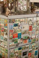 Vintage filing cabinet covered in old magnets with Paris motifs