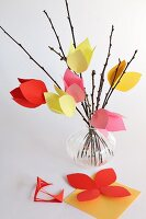 Vase of hand-crafted tulips made from paper and twigs